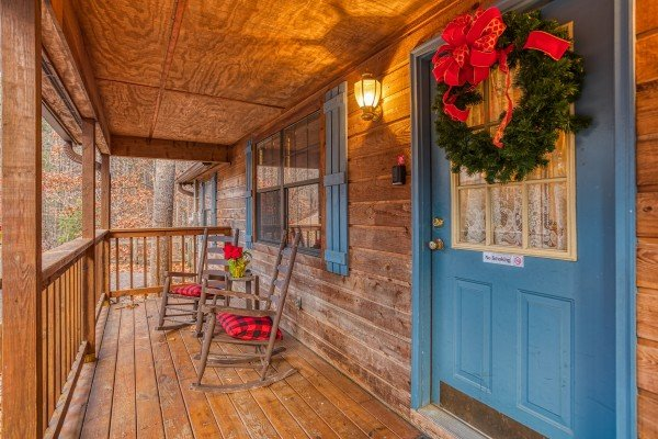 Main entrance porch with rocking chairs at Hillside Hideaway, a 1 bedroom cabin rental located in Pigeon Forge