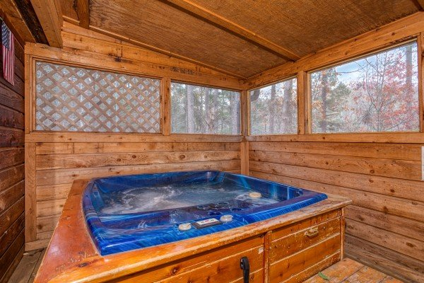 Hot tub on a covered, screened deck Hillside Hideaway, a 1 bedroom cabin rental located in Pigeon Forge