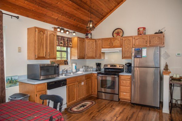 Kitchen with stainless and white appliances at Hillside Hideaway, a 1 bedroom cabin rental located in Pigeon Forge
