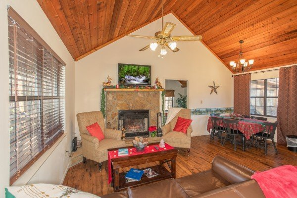 Open concept main floor with living, dining, and kitchen space at Hillside Hideaway, a 1 bedroom cabin rental located in Pigeon Forge