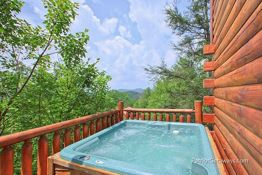 back deck with hot tub at wilderness escape a 2 bedroom cabin rental located in gatlinburg