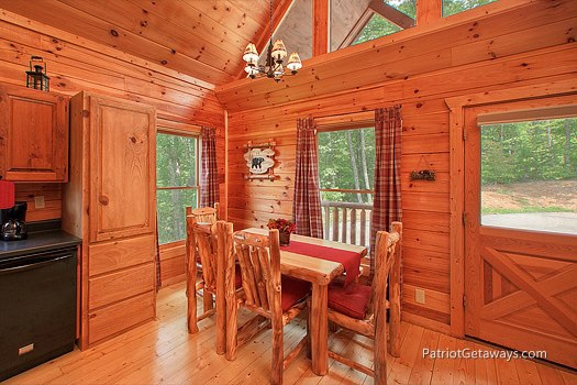 dining room with table at wilderness escape a 2 bedroom cabin rental located in gatlinburg