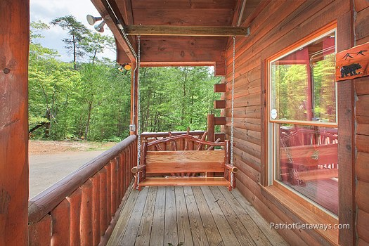 front porch with swing at wilderness escape a 2 bedroom cabin rental located in gatlinburg