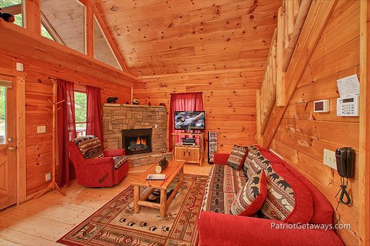 living room with fireplace at wilderness escape a 2 bedroom cabin rental located in gatlinburg