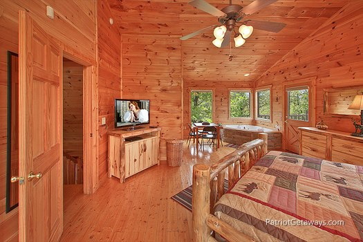 master bedroom with dresser and tv at wilderness escape a 2 bedroom cabin rental located in gatlinburg