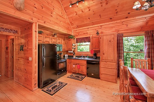 open floor plan kitchen at wilderness escape a 2 bedroom cabin rental located in gatlinburg