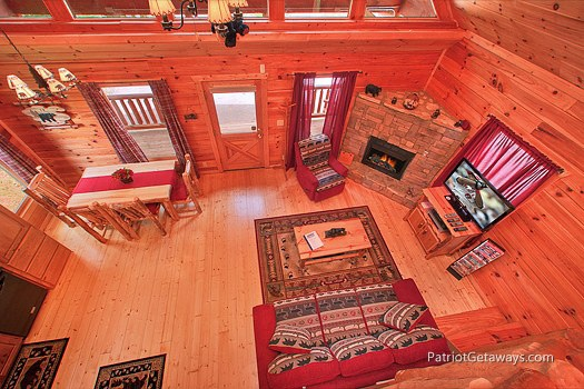 overhead view of living room with fireplace at wilderness escape a 2 bedroom cabin rental located in gatlinburg
