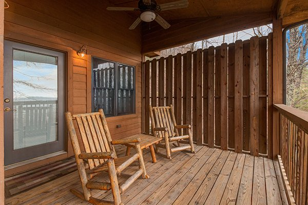 Rocking chairs on a covered porch at Valley View Lodge, a 3 bedroom cabin rental located in Pigeon Forge