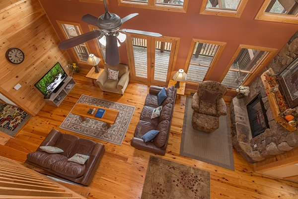 Looking down into the living room from above at Valley View Lodge, a 3 bedroom cabin rental located in Pigeon Forge