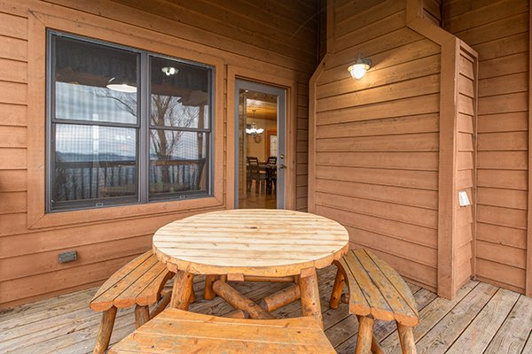 Dining table on the deck at Valley View Lodge, a 3 bedroom cabin rental located in Pigeon Forge