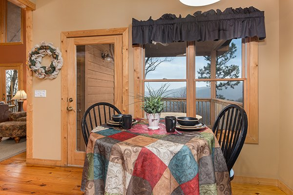 Dining nook for two at Valley View Lodge, a 3 bedroom cabin rental located in Pigeon Forge