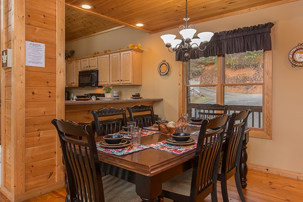 Dining table with seating for six at Valley View Lodge, a 3 bedroom cabin rental located in Pigeon Forge