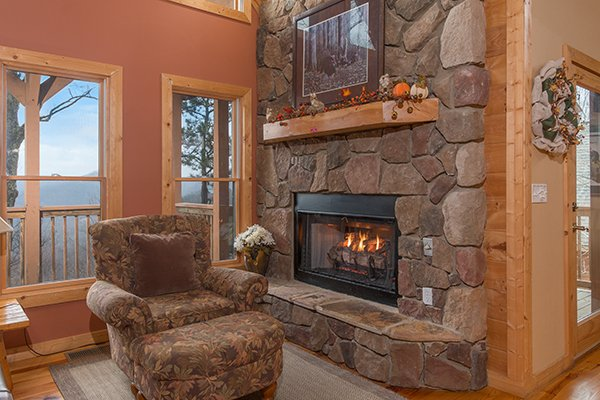 Fireplace and a chair with ottoman at Valley View Lodge, a 3 bedroom cabin rental located in Pigeon Forge