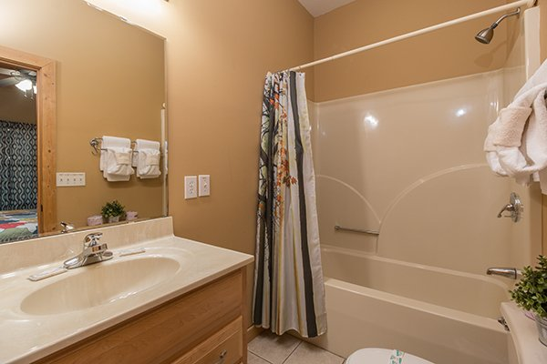 Bathroom with a tub and shower at Valley View Lodge, a 3 bedroom cabin rental located in Pigeon Forge