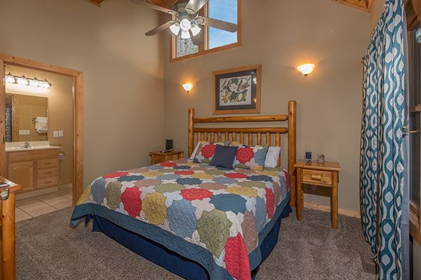 King bedroom with en suite bath at Valley View Lodge, a 3 bedroom cabin rental located in Pigeon Forge