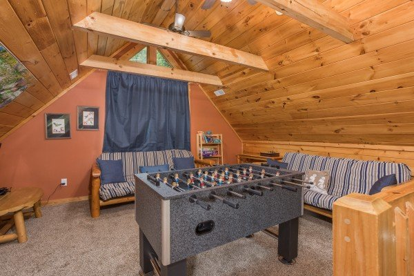 Foosball table in the loft space at Valley View Lodge, a 3 bedroom cabin rental located in Pigeon Forge