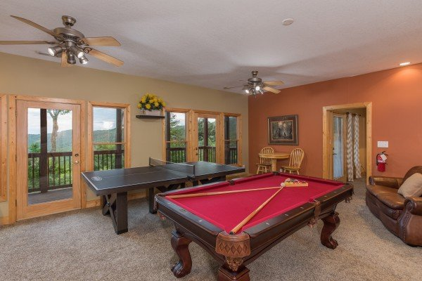 Game room with pool table and ping pong at Valley View Lodge, a 3 bedroom cabin rental located in Pigeon Forge