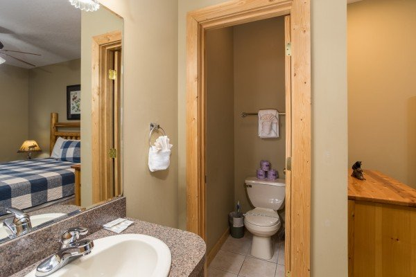 En suite half bath for the second bedroom at Valley View Lodge, a 3 bedroom cabin rental located in Pigeon Forge