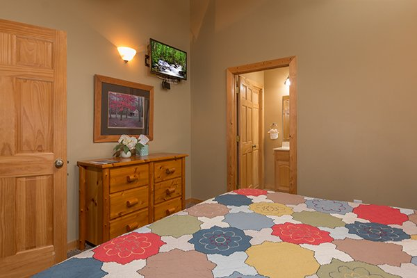 Dresser and TV in a king bedroom at Valley View Lodge, a 3 bedroom cabin rental located in Pigeon Forge