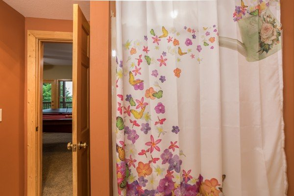 Tub and shower in a bathroom at Valley View Lodge, a 3 bedroom cabin rental located in Pigeon Forge