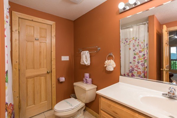 En suite bath for the main floor king bedroom at Valley View Lodge, a 3 bedroom cabin rental located in Pigeon Forge