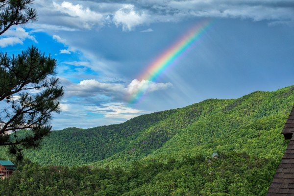 Mountains and a rainbow at Valley View Lodge, a 3 bedroom cabin rental located in Pigeon Forge