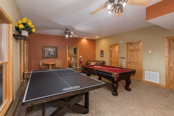 Ping pong and pool tables in the game room at Valley View Lodge, a 3 bedroom cabin rental located in Pigeon Forge