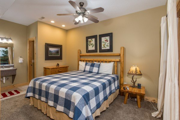 Bedroom with a king bed and en suite bath at Valley View Lodge, a 3 bedroom cabin rental located in Pigeon Forge