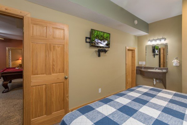 Bedroom with a TV and en suite bath at Valley View Lodge, a 3 bedroom cabin rental located in Pigeon Forge