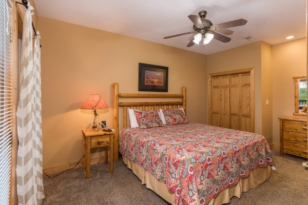 Bedroom with a king bed and dresser at Valley View Lodge, a 3 bedroom cabin rental located in Pigeon Forge