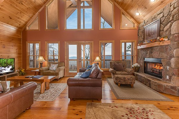 Vaulted living room with high windows at Valley View Lodge, a 3 bedroom cabin rental located in Pigeon Forge