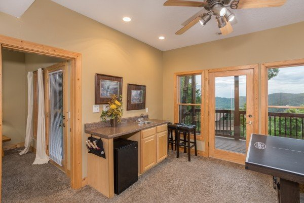 Wet bar in the game room at Valley View Lodge, a 3 bedroom cabin rental located in Pigeon Forge