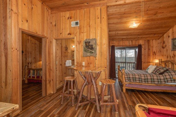 Loft bedroom with high top table at Papa Bear, a 3 bedroom cabin rental located in Pigeon Forge
