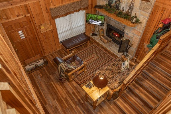 Looking down into the living room from the upper floor at Papa Bear, a 3 bedroom cabin rental located in Pigeon Forge