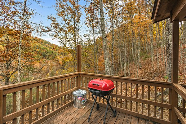 Charcoal grill on the deck at Papa Bear, a 3 bedroom cabin rental located in Pigeon Forge