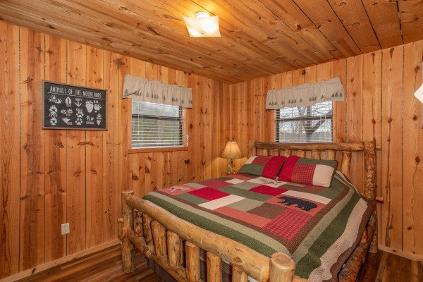 Bedroom with a log bed at Papa Bear, a 3 bedroom cabin rental located in Pigeon Forge