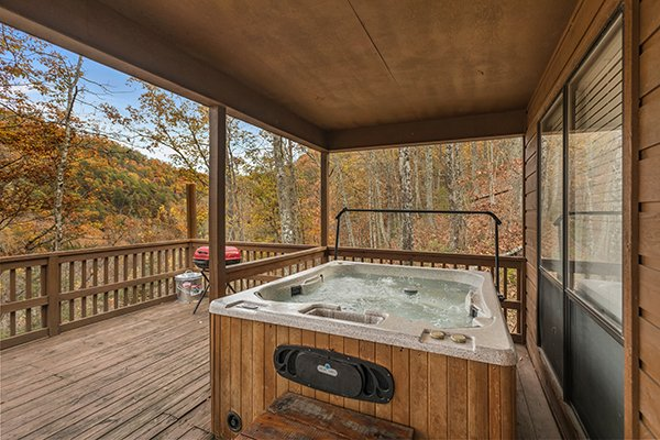 Hot tub on the covered deck at Papa Bear, a 3 bedroom cabin rental located in Pigeon Forge