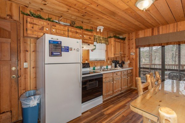 Kitchen with white appliances at Papa Bear, a 3 bedroom cabin in Pigeon Forge