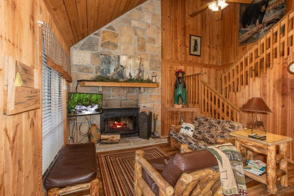 Living room with fireplace and TV at Papa Bear, a 3 bedroom cabin rental located in Pigeon Forge
