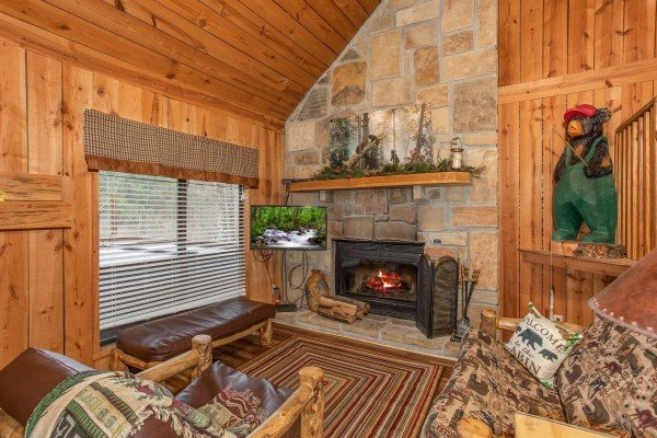 Living room with fireplace, TV, and seating at Papa Bear, a 3 bedroom cabin rental located in Pigeon Forge