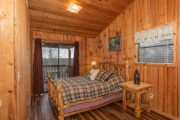 Bedroom in the loft with deck access at Papa Bear, a 3 bedroom cabin rental located in Pigeon Forge