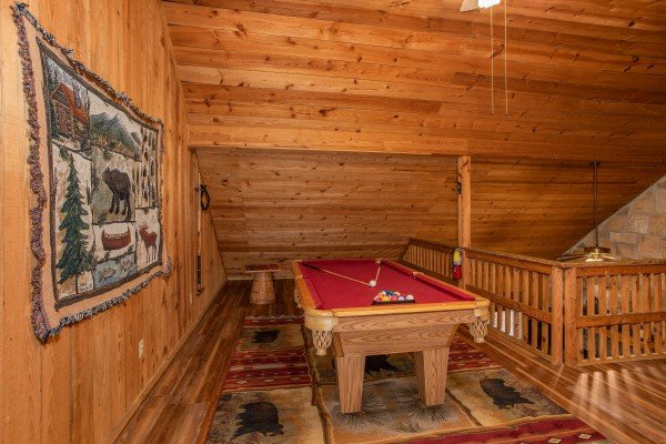 Pool table in the loft at Papa Bear, a 3 bedroom cabin rental located in Pigeon Forge