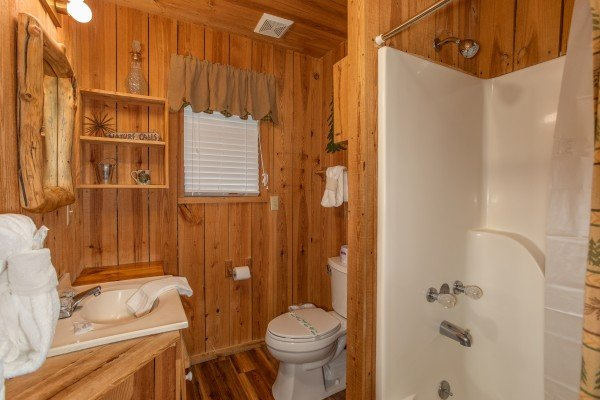 Bathroom with a tub and shower at Papa Bear, a 3 bedroom cabin in Pigeon Forge