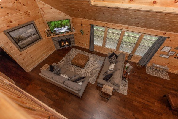 Looking down on the living room at Always Dream'n, a 6 bedroom cabin rental located in Pigeon Forge