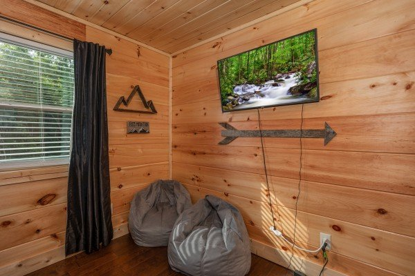 Bean bag chairs and a wall-mounted TV at Always Dream'n, a 6 bedroom cabin rental located in Pigeon Forge