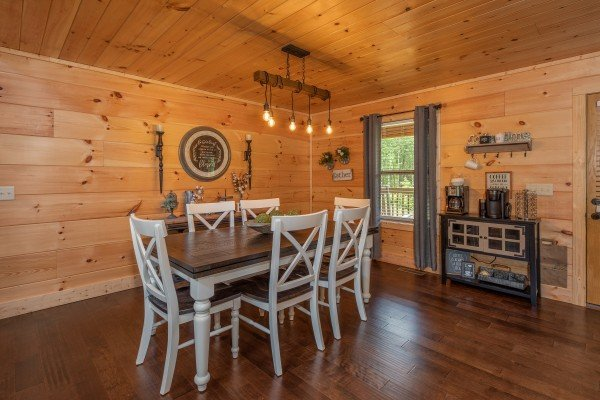 Dining table for six at Always Dream'n, a 6 bedroom cabin rental located in Pigeon Forge