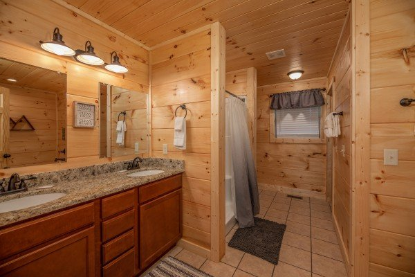 Bathroom with double vanity sinks at Always Dream'n, a 6 bedroom cabin rental located in Pigeon Forge