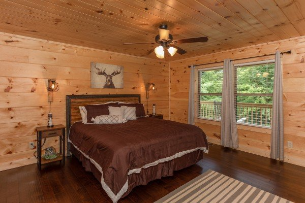 Bedroom with a king bed and two night stands at Always Dream'n, a 6 bedroom cabin rental located in Pigeon Forge
