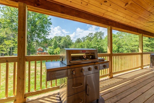 Grill on a covered deck at Always Dream'n, a 6 bedroom cabin rental located in Pigeon Forge