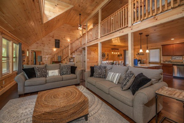 Living room with two sofas at Always Dream'n, a 6 bedroom cabin rental located in Pigeon Forge